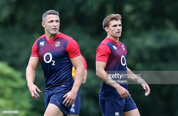 New caps Sam Burgess and Henry Slade who have been selected as centres for England in the match against France on Saturday look on during the England...