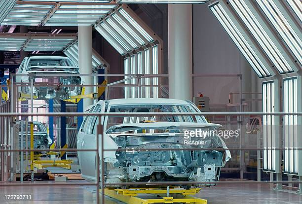 A new car chassis is assembled in a manufacturing plant