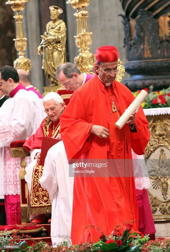 New cardinal, Bechara Boutros Rai patriarch of Antiochia receives the biretta cap from Pope Benedict XVI in Saint Peter's Basilica on November 24, 2012 in Vatican City, Vatican. The Pontiff installed 6 new cardinals during the ceremony, who will be responsible for choosing his successor.