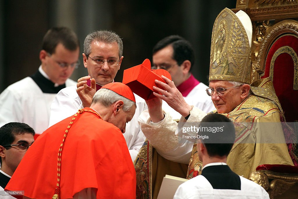 New cardinal <a gi-track='captionPersonalityLinkClicked' href=/galleries/search?phrase=Donald+William+Wuerl&family=editorial&specificpeople=776055 ng-click='$event.stopPropagation()'>Donald William Wuerl</a>, Archbishop of Washington, receives the biretta cap from <a gi-track='captionPersonalityLinkClicked' href=/galleries/search?phrase=Pope+Benedict+XVI&family=editorial&specificpeople=201771 ng-click='$event.stopPropagation()'>Pope Benedict XVI</a> in Saint Peter's Basilica on November 20, 2010 in Vatican City, Vatican. The Pontiff installed 24 new cardinals during the Consistory ceremony.