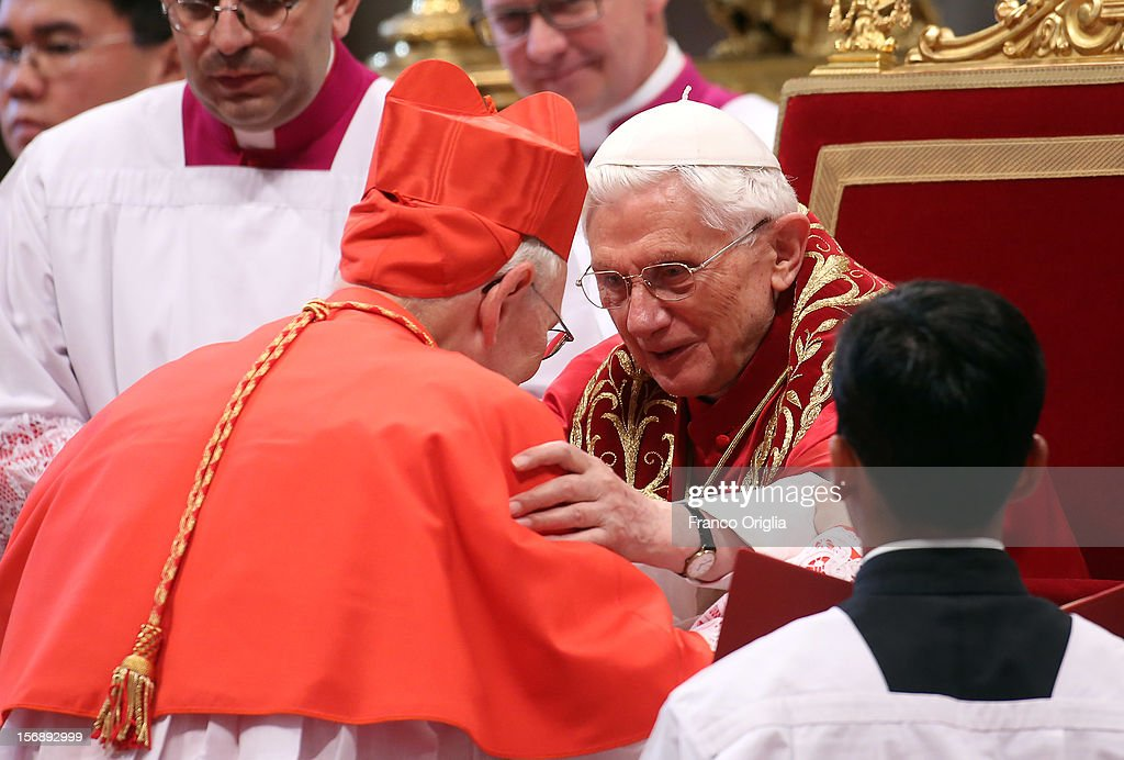New cardinal, former Prefect of the papal household, James M. Harvey receives the biretta cap from Pope Benedict XVI in Saint Peter's Basilica on November 24, 2012 in Vatican City, Vatican. The Pontiff installed 6 new cardinals during the ceremony, who will be responsible for choosing his successor.