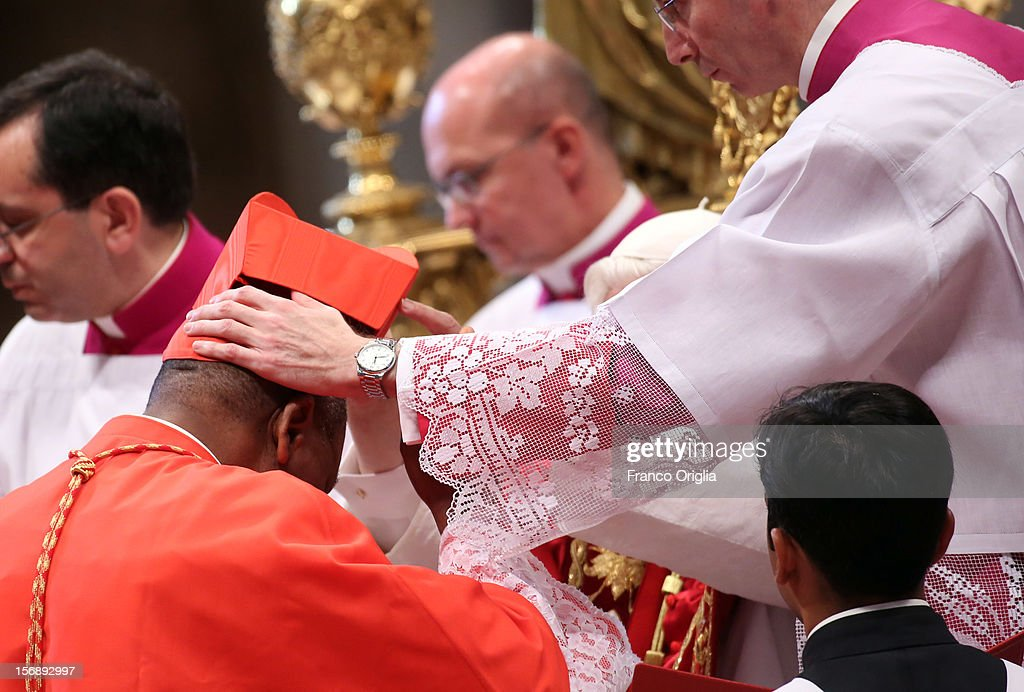 New cardinal John Olorunfemi Onaiyekan receives the biretta cap from Pope Benedict XVI in Saint Peter's Basilica on November 24, 2012 in Vatican City, Vatican. The Pontiff installed 6 new cardinals during the ceremony, who will be responsible for choosing his successor.