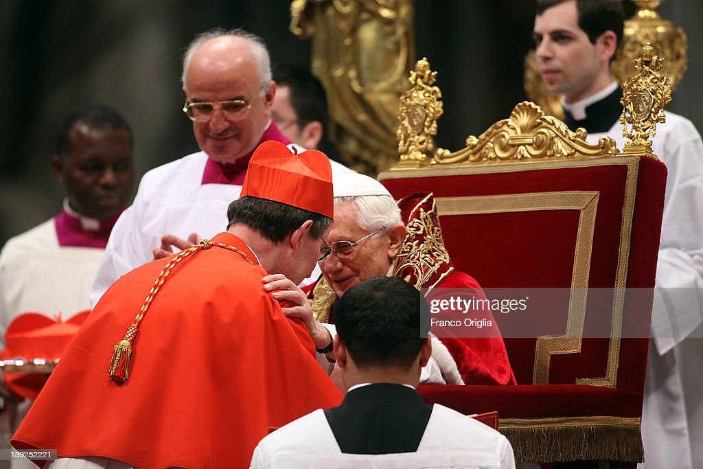 New cardinal <a gi-track='captionPersonalityLinkClicked' href=/galleries/search?phrase=Rainer+Maria+Woelki&family=editorial&specificpeople=7942695 ng-click='$event.stopPropagation()'>Rainer Maria Woelki</a> (L), Archbishop of Berlin receives the biretta cap from <a gi-track='captionPersonalityLinkClicked' href=/galleries/search?phrase=Pope+Benedict+XVI&family=editorial&specificpeople=201771 ng-click='$event.stopPropagation()'>Pope Benedict XVI</a> in Saint Peter's Basilica on February 18, 2012 in Vatican City, Vatican. The 84 year old Pontiff installed 22 new cardinals during the ceremony, who will be responsible for choosing his successor.