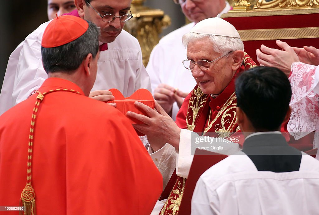 New cardinal, Ruben Salazar Gomez, archbishop of Bogotˆ, receives the biretta cap from Pope Benedict XVI in Saint Peter's Basilica on November 24, 2012 in Vatican City, Vatican. The Pontiff installed 6 new cardinals during the ceremony, who will be responsible for choosing his successor.