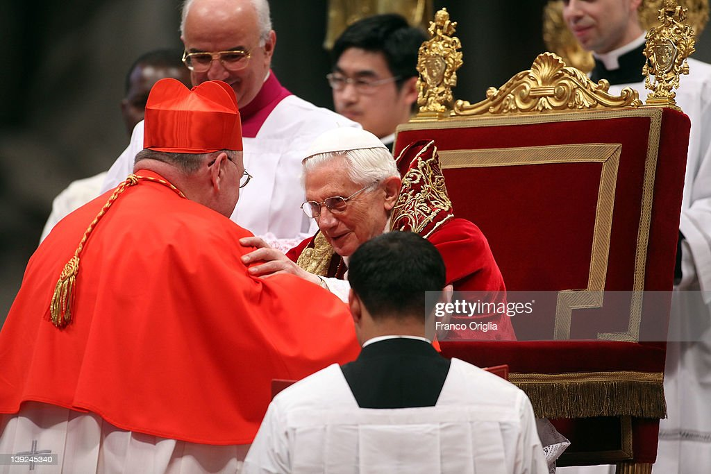 New cardinal Timothy Michael Dolan Archbishop of New York receives the biretta cap from Pope Benedict XVI in Saint Peter's Basilica on February 18...
