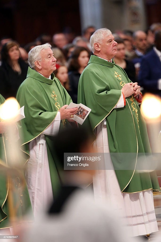 New cardinals Archbishop of Westminster <a gi-track='captionPersonalityLinkClicked' href=/galleries/search?phrase=Vincent+Nichols&family=editorial&specificpeople=5863620 ng-click='$event.stopPropagation()'>Vincent Nichols</a> (L) and Gerhard Ludwig Muller (R) attend a mass with newly appointed cardinals held by Pope Francis at St Peter's Basilica on February 23, 2014 in Vatican City, Vatican. Pope Francis presided over Mass in Saint PeterÕs Basilica on Sunday, one day after 19 bishops were added to the college of cardinals.