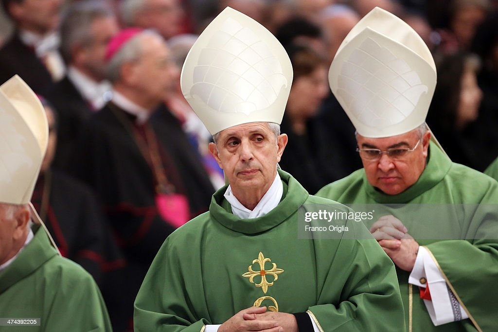 New cardinals Mario Aurelio Poli (C), archbishop of Buenos Aires, and <a gi-track='captionPersonalityLinkClicked' href=/galleries/search?phrase=Orani+Joao+Tempesta&family=editorial&specificpeople=7074913 ng-click='$event.stopPropagation()'>Orani Joao Tempesta</a> (R), archbishop of Rio de Janeiro attend a mass with newly appointed cardinals held by Pope Francis at St Peter's Basilica on February 23, 2014 in Vatican City, Vatican. Pope Francis presided over Mass in Saint Peter's Basilica on Sunday, one day after 19 bishops were added to the college of cardinals.
