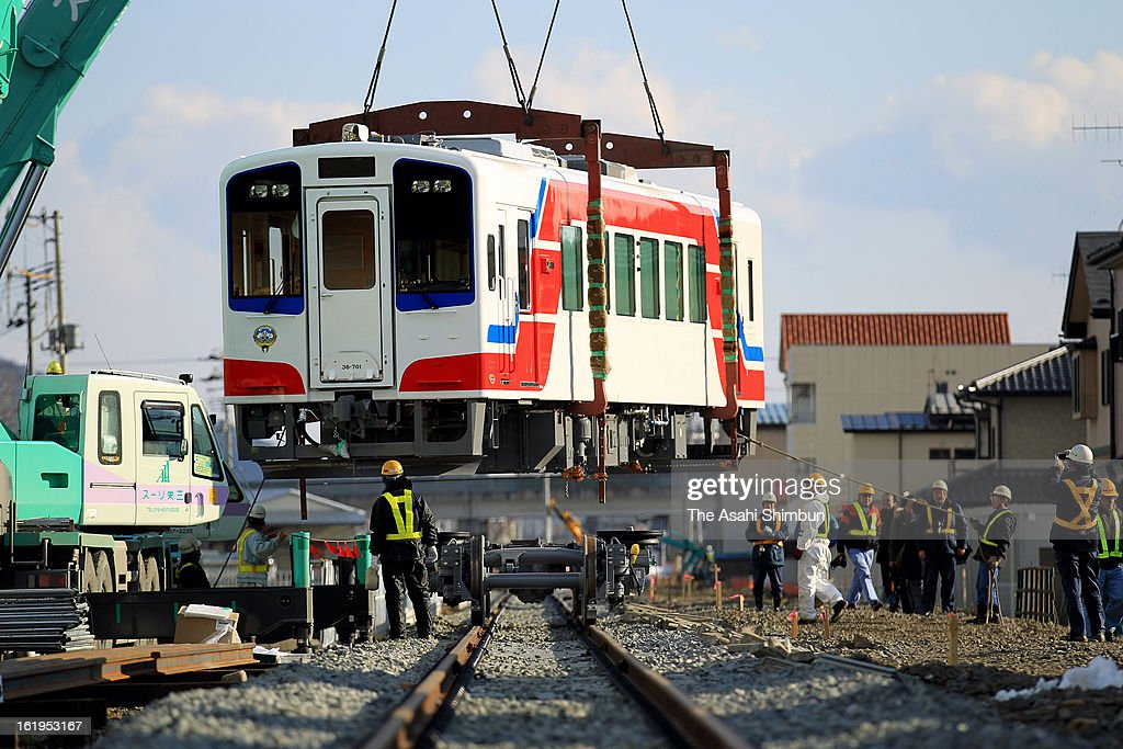 A new carriage of Sanriku Railways Co. Minami Rias Line is unloaded to the rail as a preparation for a partial service restart on February 16, 2013 in Ofunato, Iwate, Japan. The line is out of service since the tsunami triggered by magnitude 9.0 earthquake two years ago. The railway will resume 21.6 kilometers between Sakari and Yoshihama on April 3 out of 36.6 kilometers whole line, after the company purchased 3 new carriages financially supported by Kuwait.
