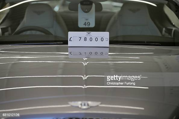 New cars are seen for sale at a Bentley dealership on January 5 2017 in Knutsford England The Society of Motor Manufacturers and Traders have...