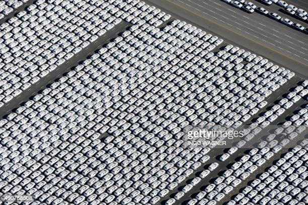 New cars of German car maker Volkswagen stand ready for shipping next to the Volkswagen plant in Emden northwestern Germany on September 30 2015...