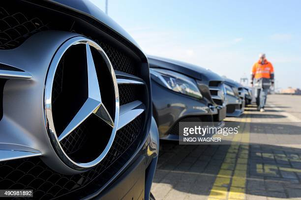 New cars of MercedesBenz are parked ready for shipping at the car terminal of the port of Bremerhaven northwestern Germany on October 2 2015 New car...