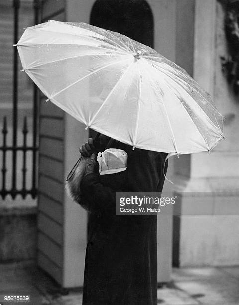 A new cellophane umbrella on the streets of London 2nd March 1937