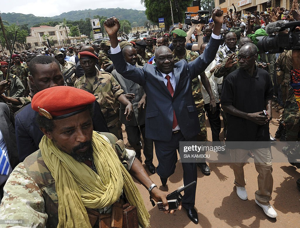 New Central African Republic leader Michel Djotodia (C) arrives on Republic Plaza in Bangui on March 30, 2013 . The Central African Republic's new strongman Michel Djotodia vowed Saturday not to contest 2016 polls and hand over power at the end of the three-year transition he declared after his coup a week ago.