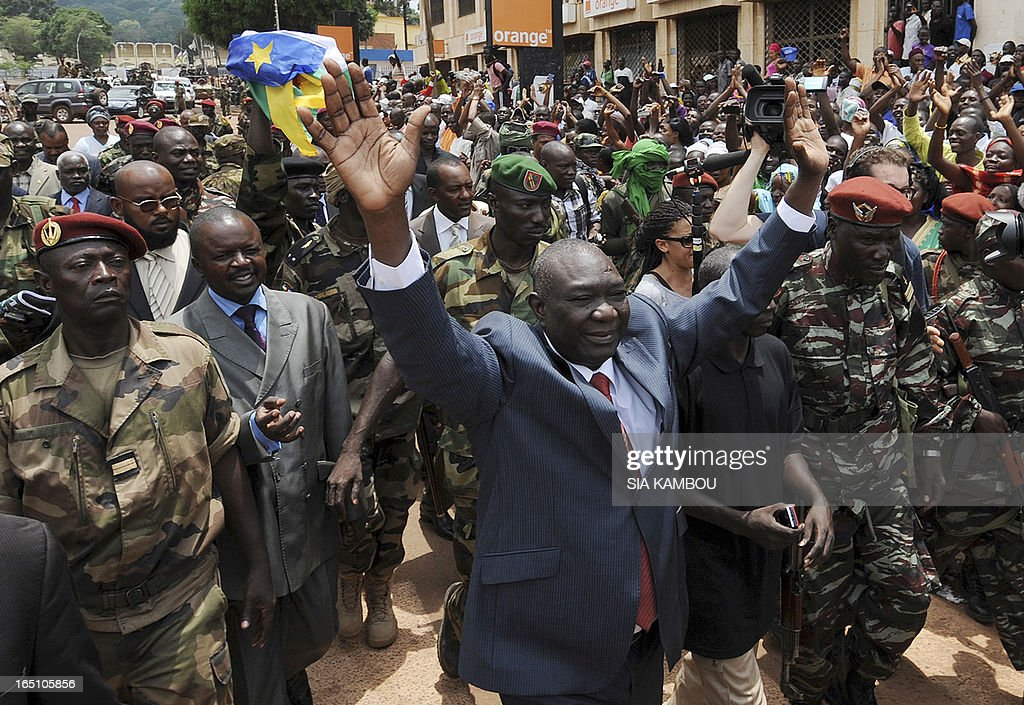 New Central African Republic leader Michel Djotodia arrives on Republic Plaza in Bangui on March 30, 2013 . The Central African Republic's new strongman Michel Djotodia vowed Saturday not to contest 2016 polls and hand over power at the end of the three-year transition he declared after his coup a week ago. AFP PHOTO / SIA KAMBOU