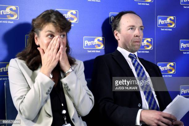 New chairman of the Finns Party Jussi Hallaaho and party secretary Riikka SlungaPoutsalo react during a press conference in Helsinki Finland on June...