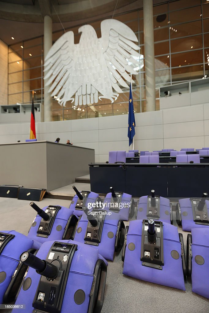 New chairs lie in the plenary hall of the Bundestag shortly before workers installed them on October 17, 2013 in Berlin, Germany. Workers installed new chairs and rearranged seating in order to accomodate the new constellation of party factions as well as the slightly higher number of parliamentarians voted in for the 18th legislative period following recent German elections. The new Bundestag will convene for th first time on October 22.