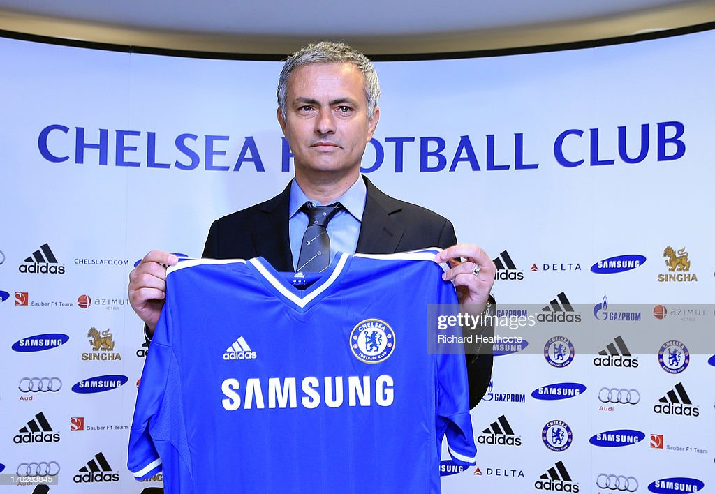 New Chelsea manager Jose Mourinho holds up the shirt before the Chealsea FC press conference at Stamford Bridge on June 10, 2013 in London, England. Mourinho is returning to Chelsea for a second spell in charge of the West London Premier League team.