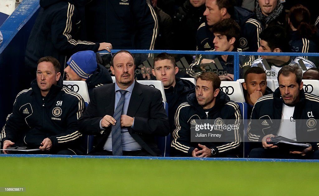 New Chelsea manager Rafael Benitez (2nd L) takes his place in the team dug out during the Barclays Premier League match between Chelsea and Manchester City at Stamford Bridge on November 25, 2012 in London, England.