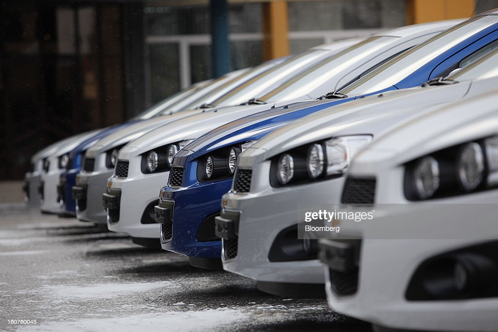 New Chevrolet Aveo automobiles, a division of General Motors Co. (GM), stand outside the GAZ Group assembly plant in Niznhy Novgorod, Russia, on Tuesday, Feb. 5, 2013. GAZ, which is controlled by Russian billionaire Oleg Deripaska, plans to make 30,000 Aveo sedans and hatchbacks a year at its plant in Nizhny Novgorod starting in mid-2012. Photographer: Alexander Zemlianichenko Jr./Bloomberg via Getty Images