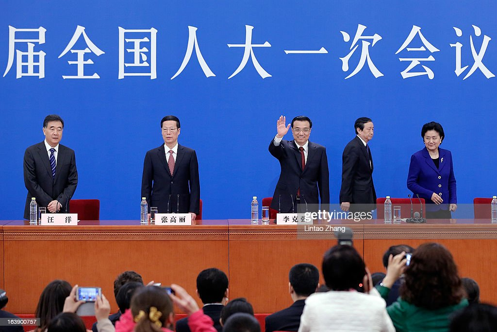 New Chinese Premier Li Keqiang (Center) attend his first press conference with he is flanked by newly-elected vice premiers Zhang Gaoli (2nd-L), Ma Kai (2nd-R), Liu Yandong (R) and Wang Yang (L) after the closing session of the National People's Congress (NPC) at the Great Hall of the People on March 17, 2013 in Beijing, Li Keqiang was elected as China's Premier last Friday at the 12th National People's Congress, the country's top legislature.