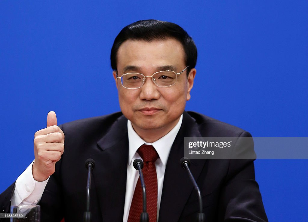 New Chinese Premier Li Keqiang gestures as he answers a question during his first press conference after the closing session of the National People's Congress (NPC) at the Great Hall of the People on March 17, 2013 in Beijing, China. Li Keqiang was elected as China's Premier last Friday at the 12th National People's Congress, the country's top legislature.
