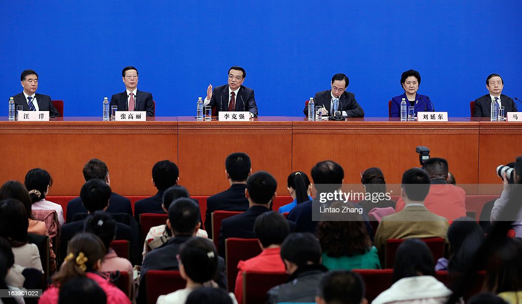 New Chinese Premier <a gi-track='captionPersonalityLinkClicked' href=/galleries/search?phrase=Li+Keqiang&family=editorial&specificpeople=2481781 ng-click='$event.stopPropagation()'>Li Keqiang</a> (2nd-L) gestures as he answers a question with he is flanked by newly-elected vice premiers Wang Yang (L),Zhang Gaoli (2nd-L), Ma Kai (R) and Liu Yandong (2nd-R) during his first press conference after the closing session of the National People's Congress (NPC) at the Great Hall of the People on March 17, 2013 in Beijing, China. <a gi-track='captionPersonalityLinkClicked' href=/galleries/search?phrase=Li+Keqiang&family=editorial&specificpeople=2481781 ng-click='$event.stopPropagation()'>Li Keqiang</a> was elected as China's Premier last Friday at the 12th National People's Congress, the country's top legislature.