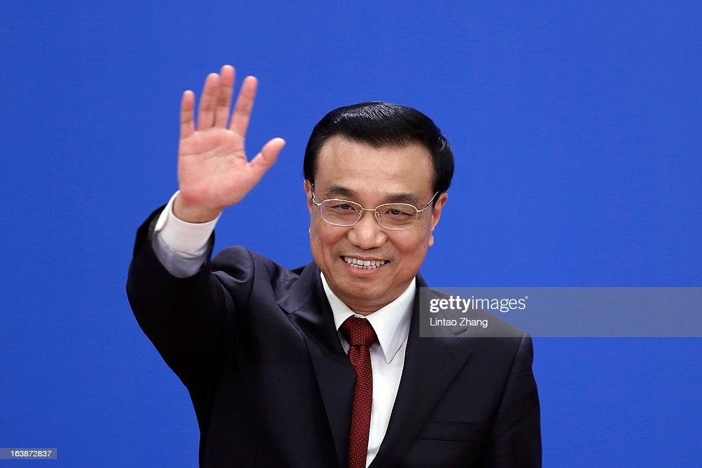 New Chinese Premier <a gi-track='captionPersonalityLinkClicked' href=/galleries/search?phrase=Li+Keqiang&family=editorial&specificpeople=2481781 ng-click='$event.stopPropagation()'>Li Keqiang</a> waves goodbye after during his first press conference at the Great Hall of the People on March 17, 2013 in Beijing, China. <a gi-track='captionPersonalityLinkClicked' href=/galleries/search?phrase=Li+Keqiang&family=editorial&specificpeople=2481781 ng-click='$event.stopPropagation()'>Li Keqiang</a> was elected as China's Premier last Friday at the 12th National People's Congress, the country's top legislature.