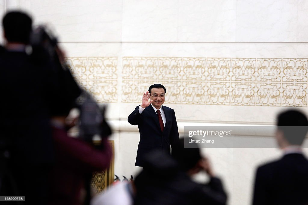 New Chinese Premier Li Keqiang waves hello before during his first press conference at the Great Hall of the People on March 17, 2013 in Beijing, China. Li Keqiang was elected as China's Premier last Friday at the 12th National People's Congress, the country's top legislature.