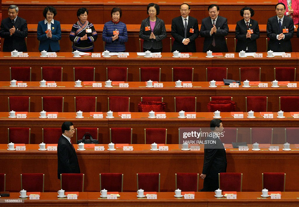 New Chinese President Xi Jinping (bottom R) leads outgoing president Hu Jintao (bottom L) into the main hall for the first time during the closing session of the National People's Congress (NPC) at the Great Hall of the People in Beijing on March 17, 2013. China's new President Xi Jinping said on March 17 he will fight for a 'great renaissance of the Chinese nation', as the world's most populous country completed its once-in-a-decade power transition. AFP PHOTO / Mark RALSTON