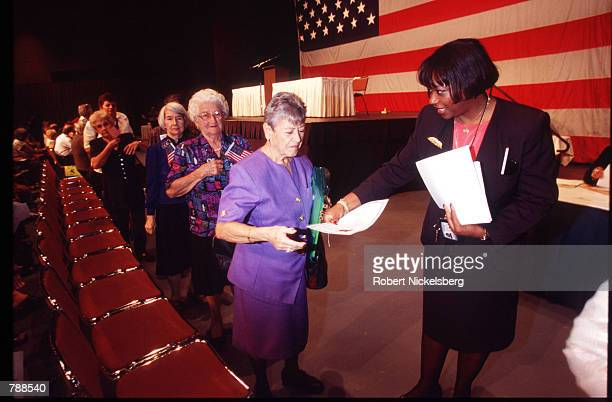 New citizens receive their naturalization certificates after the ceremony September 25 1999 in Miami FL Three thousand people attended the swearing...