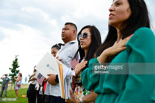 New citizens say their first Pledge of Allegiance during a naturalization ceremony August 2 2015 at Parkfield Lake Park 29 immigrants took the oath...