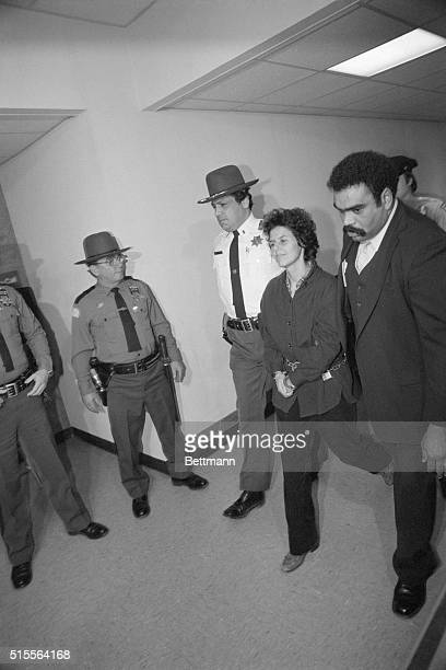 Judith Clark member of the Weather Underground accused of murder robbery and assault in the shooting of two police officers and a security guard...