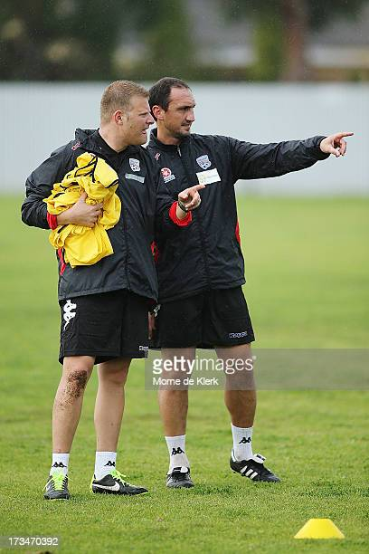 New coach of Adelaide United Josep Gombau looks on with Assistant Michael Valkanis during an Adelaide United ALeague training session at SASI on July...