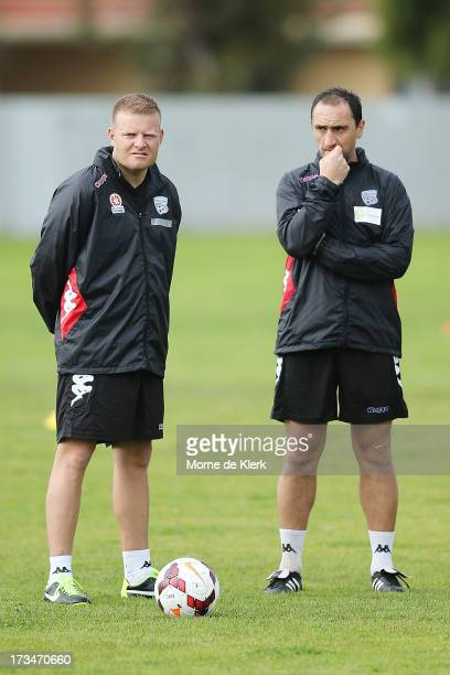 New coach of Adelaide United Josep Gombau stands with assistant Michael Valkanis as they looks on during an Adelaide United ALeague training session...