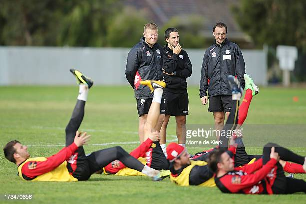 New coach of Adelaide United Josep Gombau stands with assistants as they looks on during an Adelaide United ALeague training session at SASI on July...