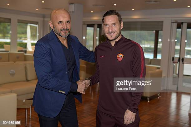 New coach of AS Roma Luciano Spalletti poses with Fancesco Totti upon arriving in Trigoria on January 14 2016 in Rome Italy