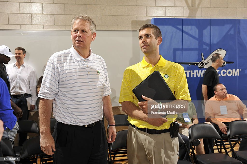 New coach of Boston Celtics <a gi-track='captionPersonalityLinkClicked' href=/galleries/search?phrase=Brad+Stevens&family=editorial&specificpeople=5022542 ng-click='$event.stopPropagation()'>Brad Stevens</a> (R) confers with Daniel Ray 'Danny' Ainge, basketball executive, President of Basketball Operations for the Boston Celtics (L) during the 2013 Southwest Airlines Orlando Pro Summer League on July 8, 2013 at Amway Center in Orlando, Florida.