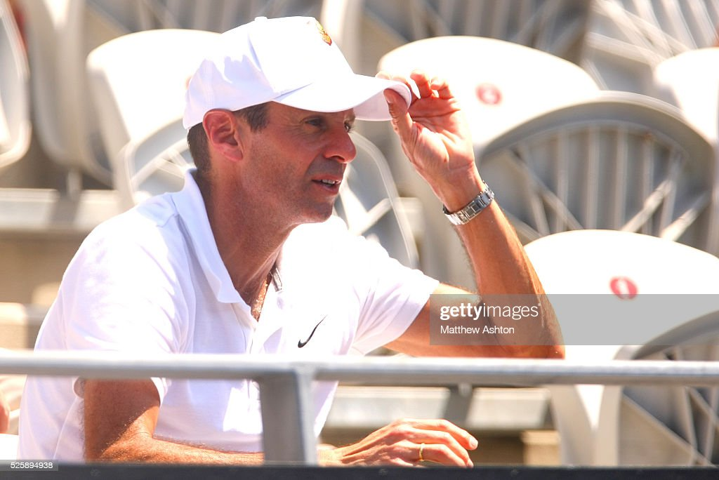 New coach of Li Na of China Carlos Rodriguez watches her in action at the Apia International Sydney 2013