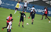 New coach of Paris SaintGermain Unai Emery directs his first training session of the season at PSG training camp Centre d'Entrainement Ooredoo on...