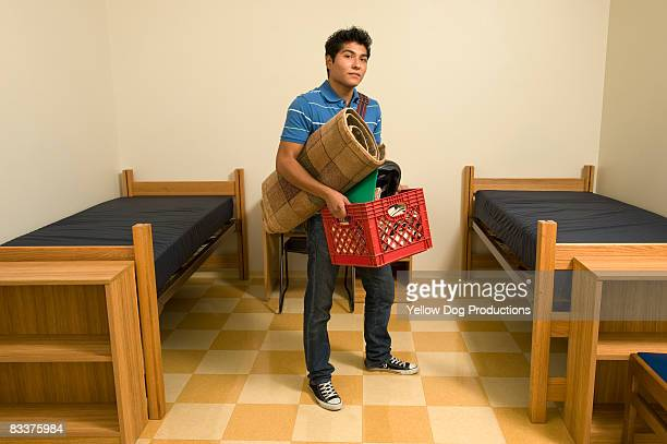 New college student entering dorm room