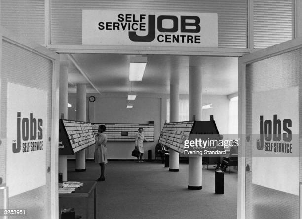 A new concept for the unemployed the Job Centre Two people seen reading the adverts