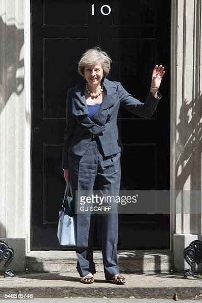 New Conservative Party leader Theresa May gestures to members of the media as she leaves 10 Downing Street in London on July 12 atfer attending Prime...