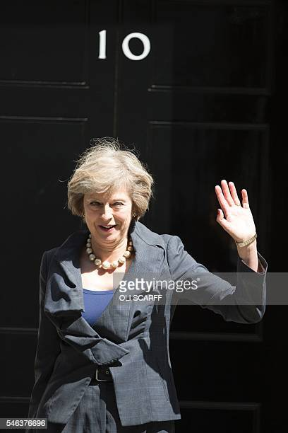 New Conservative Party leader Theresa May waves to members of the media as she leaves 10 Downing Street in London on July 12 atfer attending Prime...
