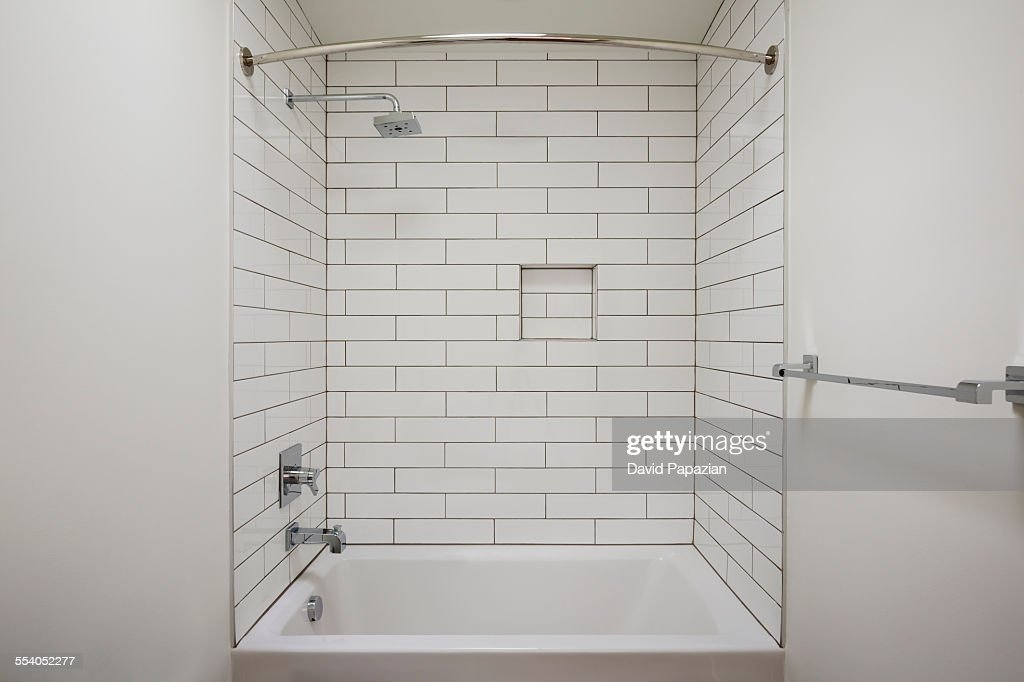 Modern Bathtub Shower new construction modern bathtub shower combo stock photo | getty