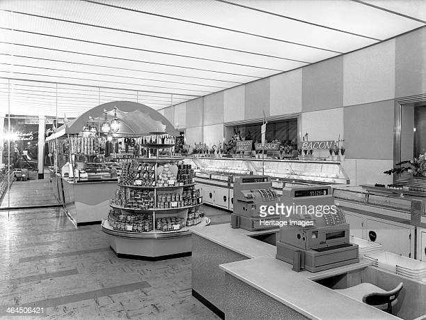 New Coop central butcher's department Barnsley South Yorkshire 1957 The meat counter is stocked with a varied selection of continental style salamis...