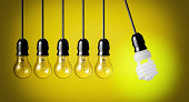 Perpetual motion with light bulbs and energy saver bulb. Idea concept