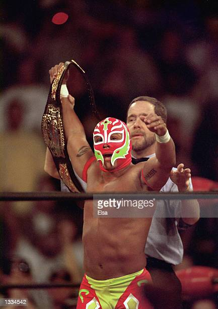 New cruiserweight champion Rey Mysterio Jr acknowledges the crowd after defeating Jericho during the WWE Bash at the Beach event at Cox Arena in San...