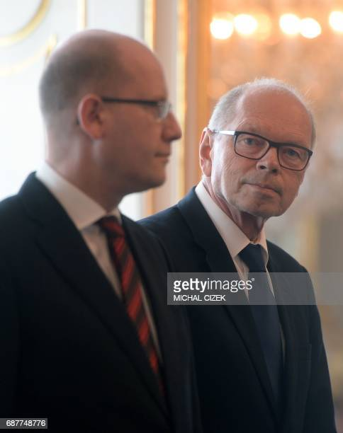New Czech Minister of Finance Ivan Pilny from the ANO party and Czech Prime Minister Bohuslav Sobotka attend the appointing ceremony of new Czech...