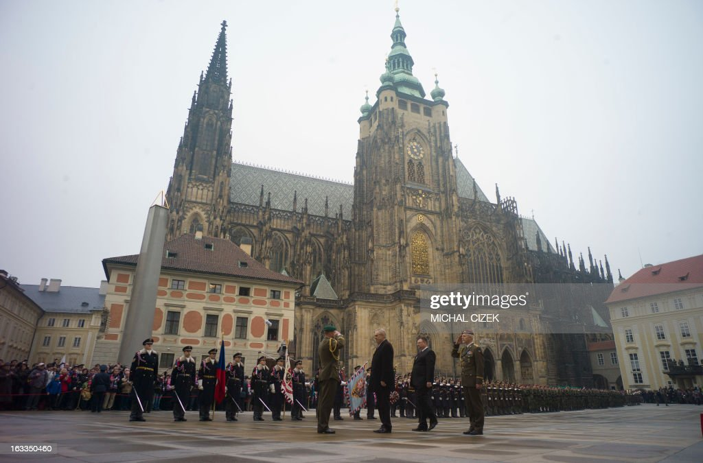 New Czech president Milos Zeman stands next to Prime Minister Petr Necas while inspecting a guard of honour near the Saint Vitus Cathedral at the...