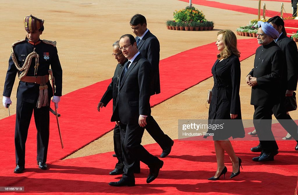 New Delhi, India, -14 February - French President Francois Hollande with partner Valerie Trierweiler,President Pranab Mukherjee and Prime Minister Manmohan Singh during a ceremonial reception accorded to Hollande at the presidential palace on February 14, 2013 in New Delhi, India.
